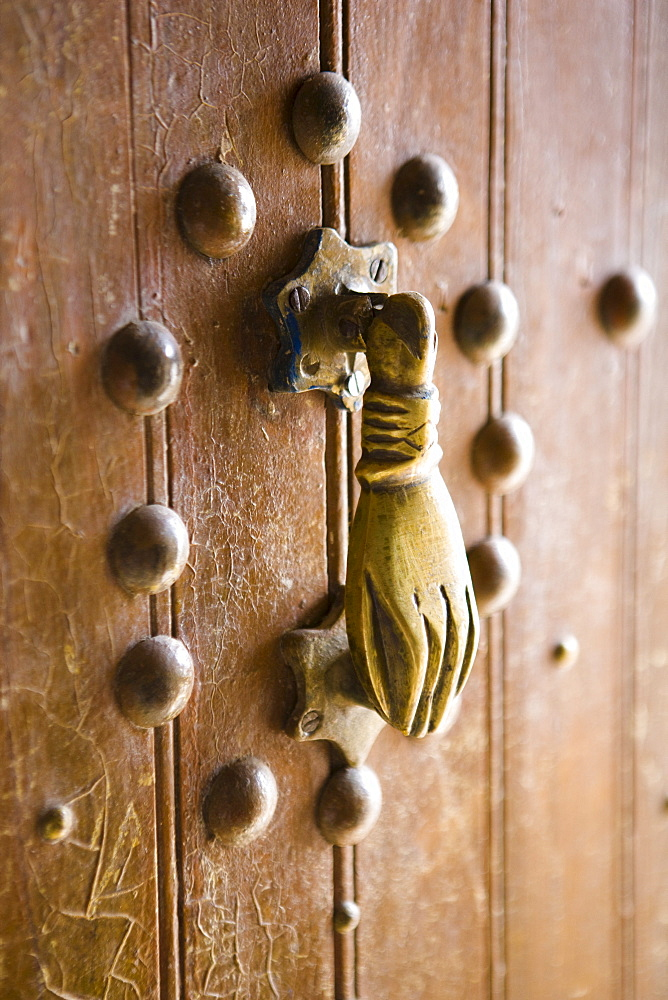 Brass Hand of Fatima door knocker, a popular symbol in Southern Morocco, Merzouga, Morocco, North Africa, Africa