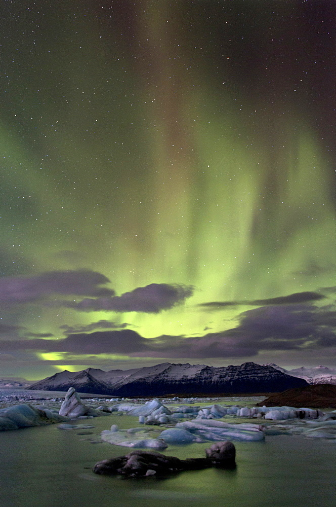 The Aurora Borealis (Northern Lights) captured in the night sky over Jokulsarlon glacial lagoon on the edge of the Vatnajokull National Park, during winter, South Iceland, Iceland, Polar Regions