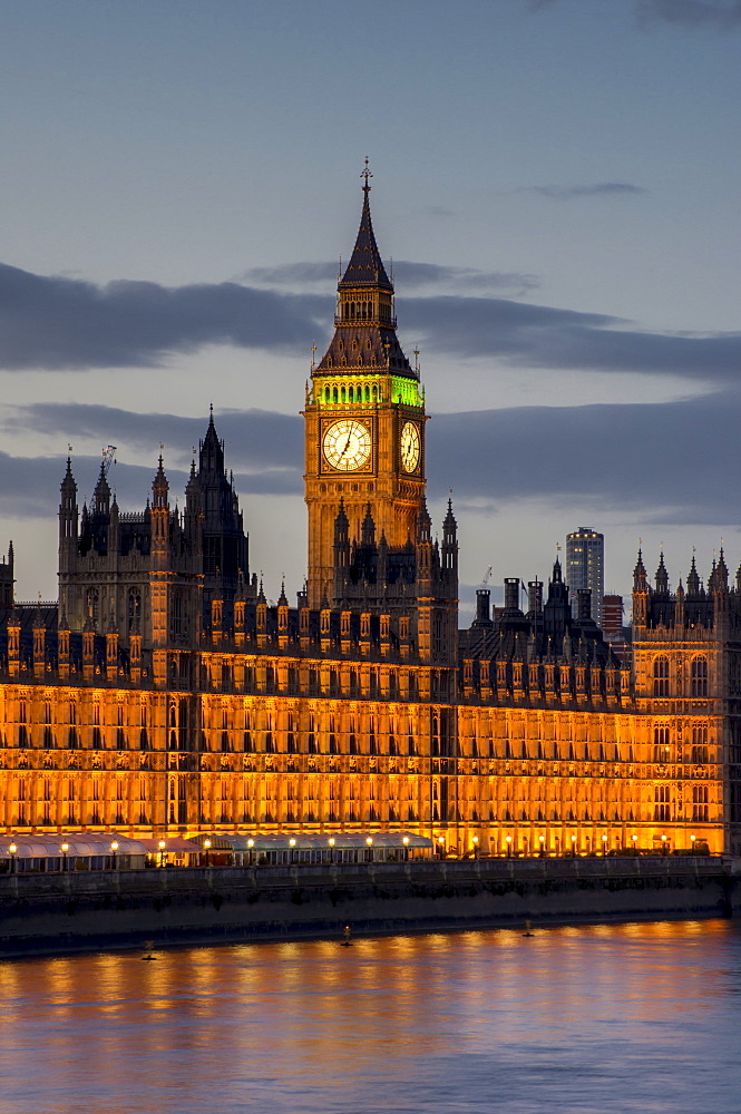 Big Ben clock tower stands above the Houses of Parliament at dusk, UNESCO World Heritage Site, Westminster, London, England, United Kingdom, Europe