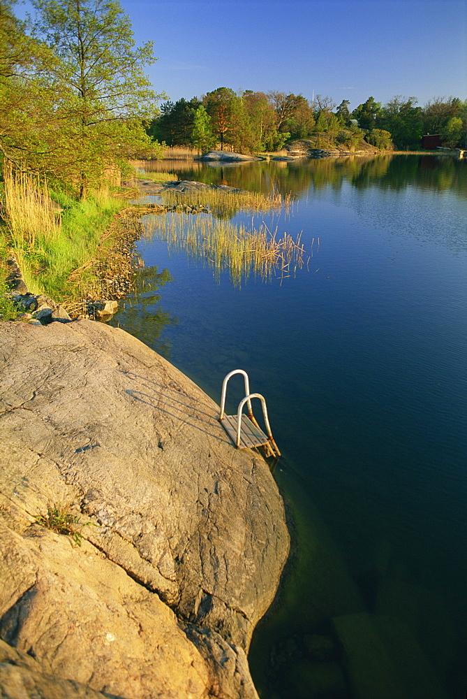 Steps placed beside lake to help bathers, Rosenon Island, near Dalaro, Sweden, Scandinavia, Europe
