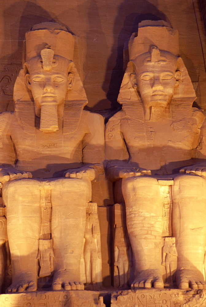 Floodlit colossi of Ramses II (Ramesses the Great), seated statues on facade of temple, Abu Simbel, UNESCO World Heritage Site, Nubia, Egypt, North Africa, Africa