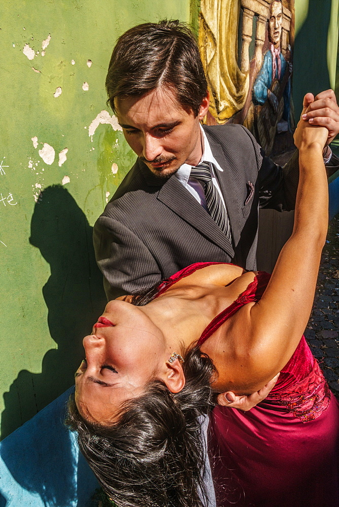 Street tango dancers on the corner of El Caminito, La Boca, Buenos Aires, Argentina, South America