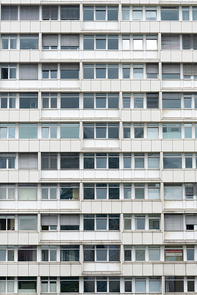 White and grey uniform facade of old apartment block, Berlin, Germany, Europe