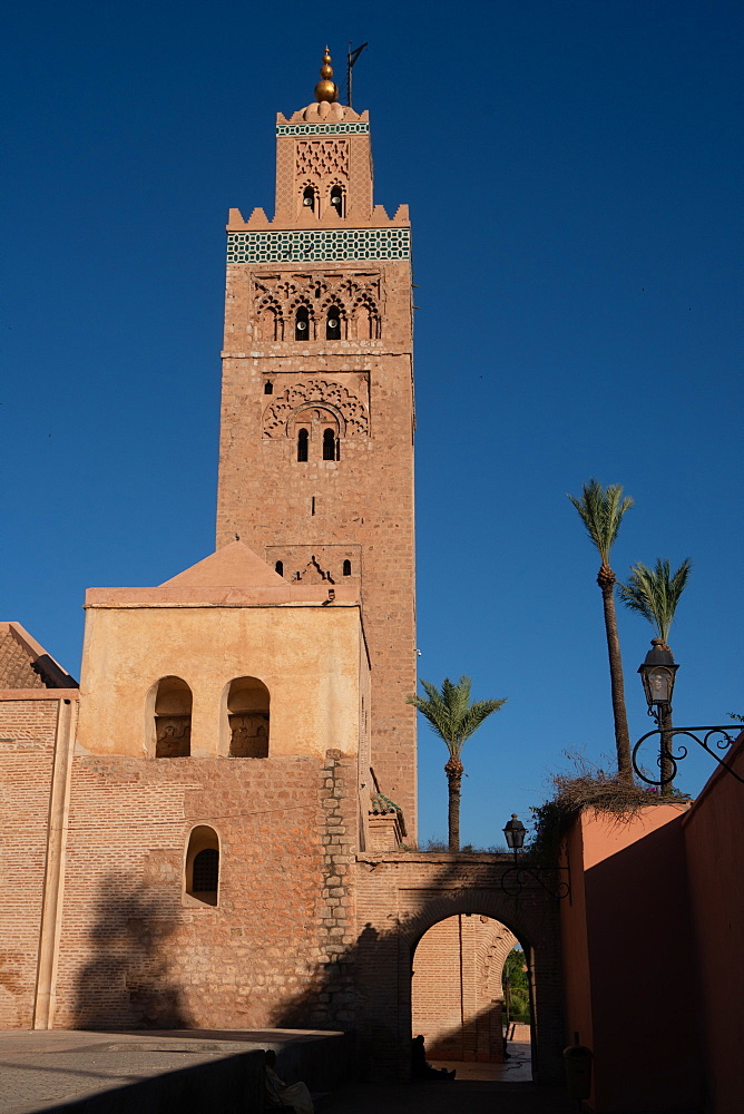 Minaret of the landmark Koutoubia Mosque, against an azure blue sky, Medina of Marrakesh, UNESCO World Heritage Site, Morocco