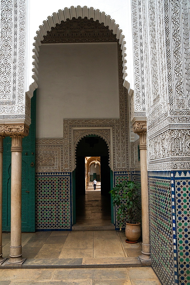 Man wanders down a long corridor decorated in Moorish style, Mahkama du Pacha, former Law Courts, Casablanca, Morocco, North Africa, Africa - 450-4403