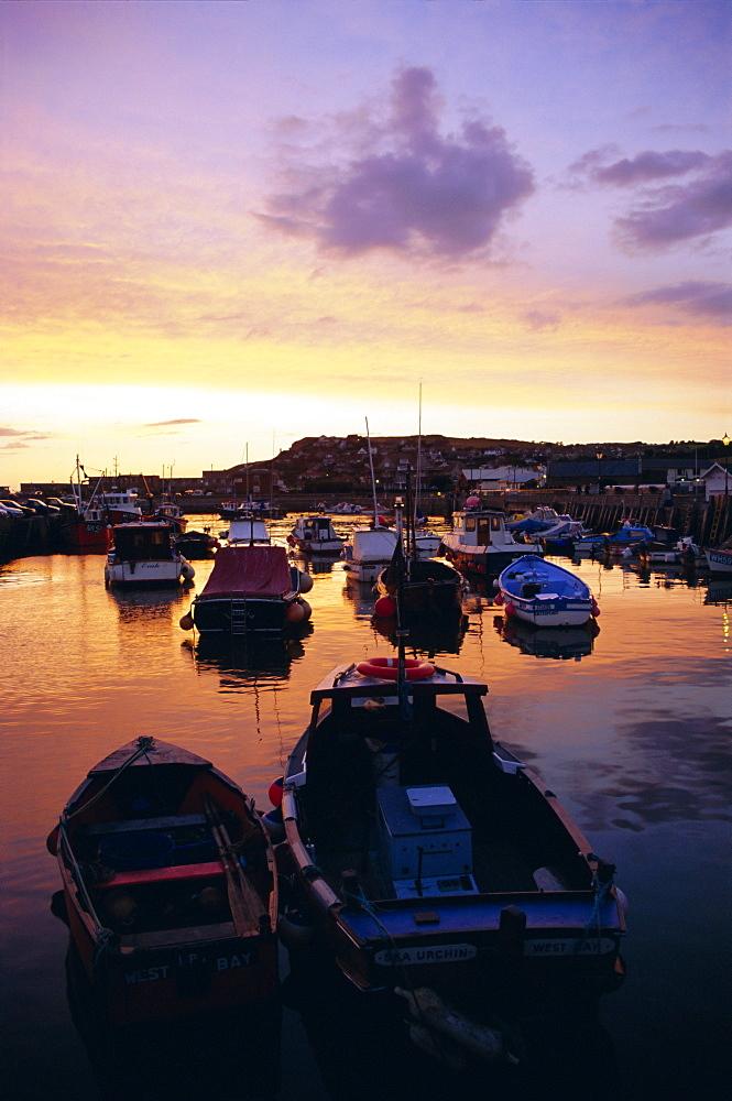 Harbour at sunset, West Bay, Dorset, England, UK, Europe