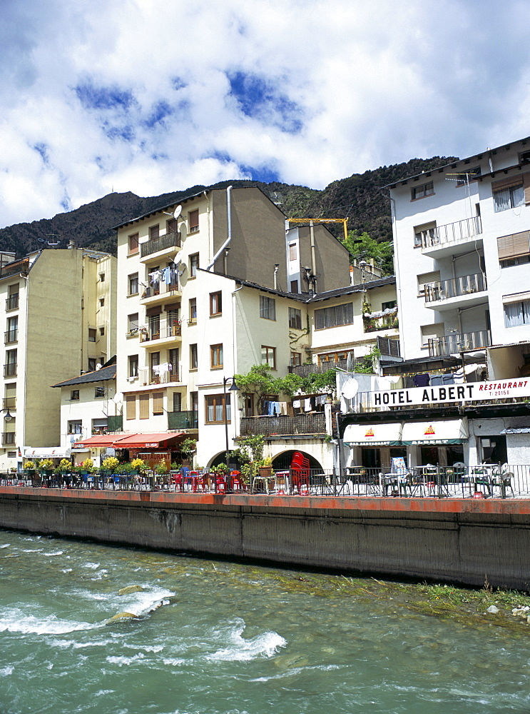 Street cafes on the bank of Riu Valira which runs through the capital city, Andorra la Vella, Andorra, Europe - 586-1151
