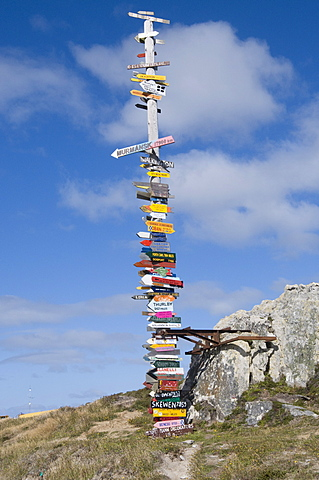 Signs with mileage to world destinations made into a totem pole, Port Stanley, Falkland Islands, South America
