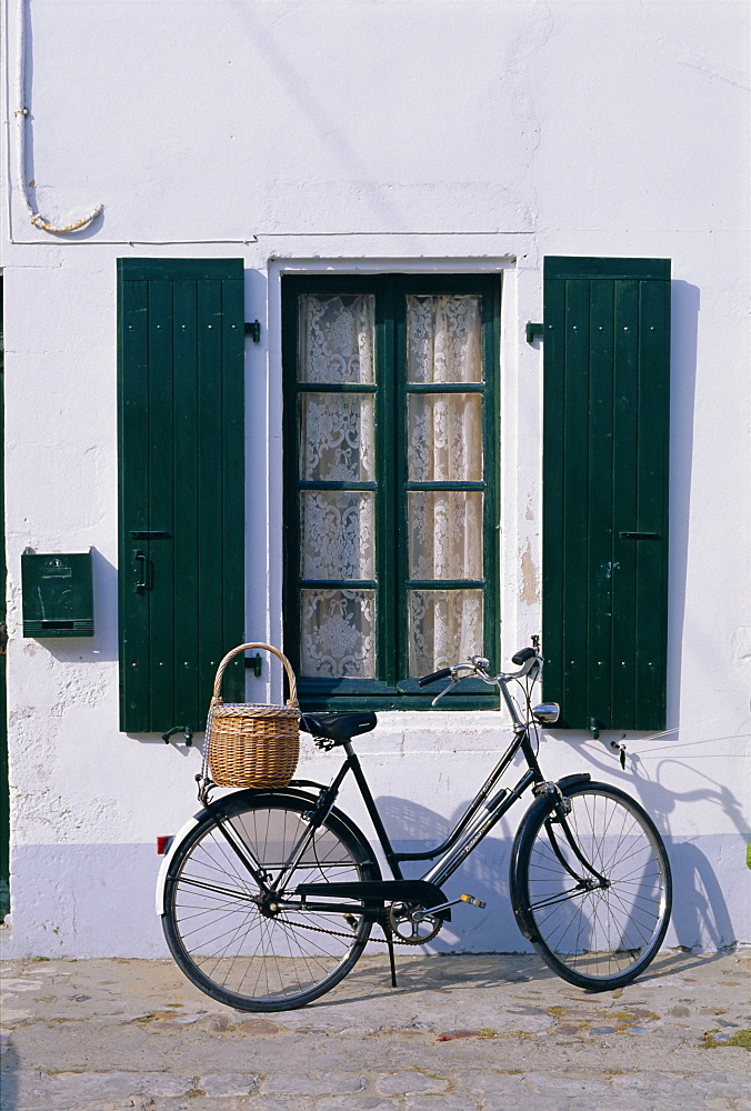 Bicycle leaning against a wall, Ile de Re, France, Europe