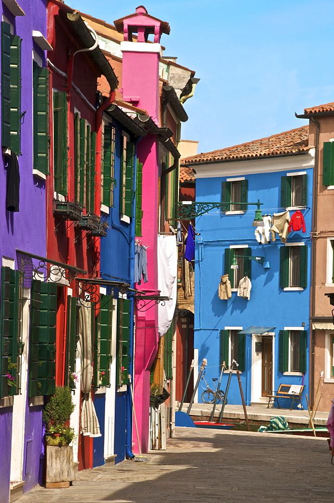 A street with washing drying at windows, Burano Island, Venice, Veneto, Italy, Europe - 665-5000