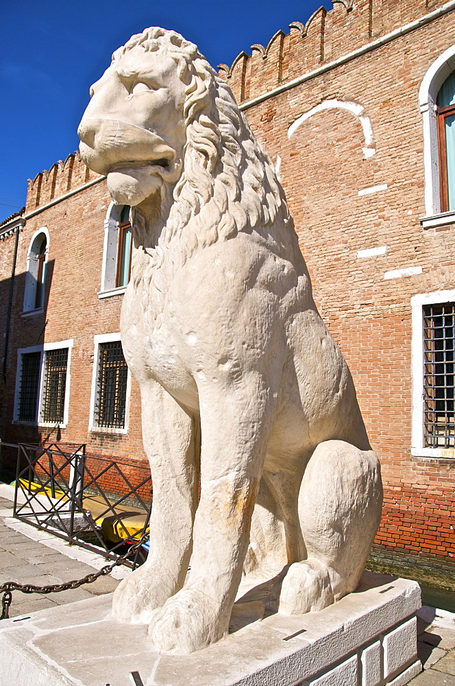 Greek antique lion statue outside the land entrance to the Arsenal, Venice, Veneto, Italy, Europe