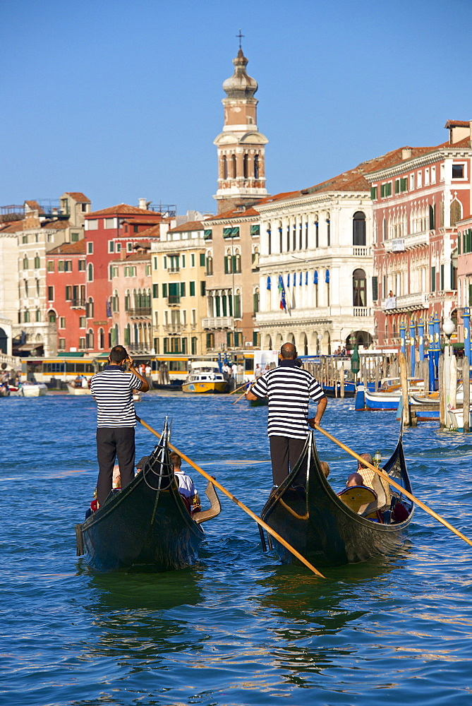 Gondolas and gondoliers, palaces facades and church steeple, Grand Canal, Venice, UNESCO World Heritage Site, Veneto, Italy, Europe - 665-5474