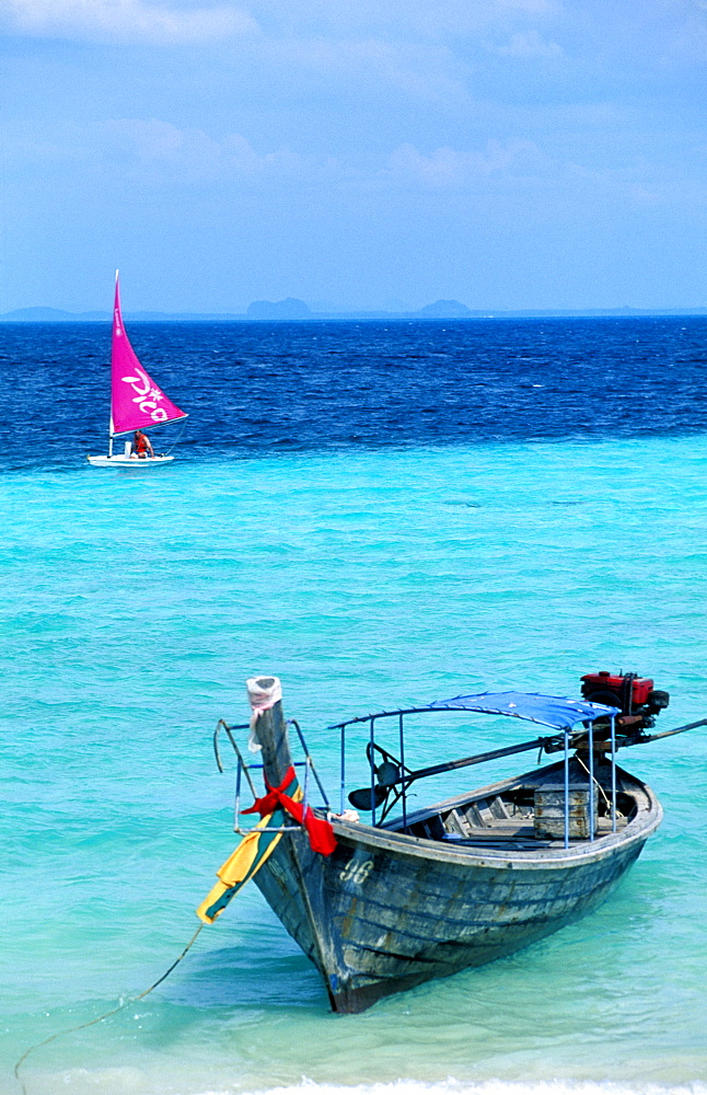 Thailand, Phuket Island, (Near) , Koh Phi Phi Islands, Windsurf And Long Tail Outrigger On A Beach