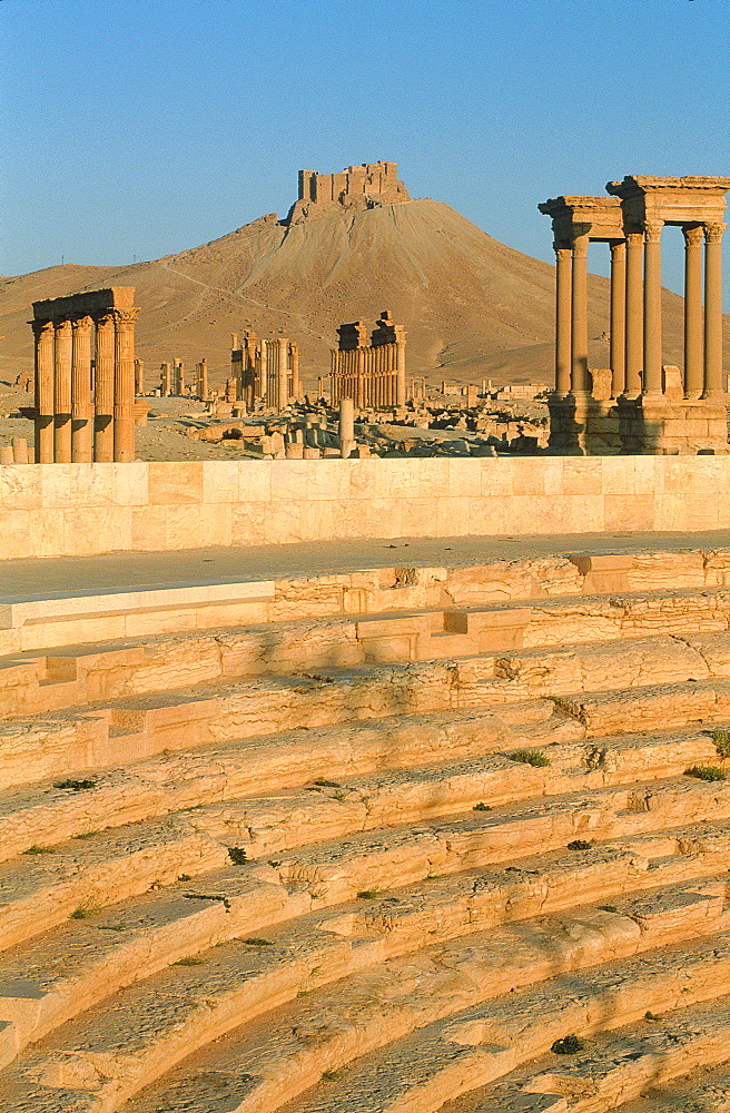 Syria, Palmyra Oasis, The Roman City Ruins, Remnants Of The 1200m Columnade Edging The Cardo (Main Road In The Roman Cities Center), In Fore The Open Air Theatre Then The Tetrapylons Built To Shelter 4 Statues, At Rear The Arab Castle On Top Of A Hill