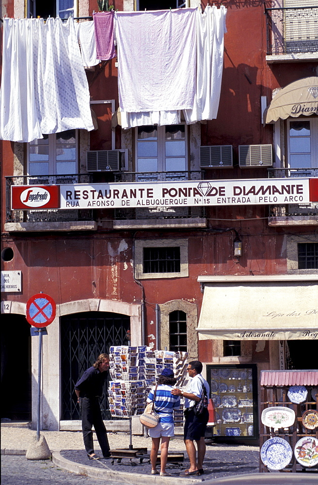 Portugal, Lisbon, Alfama Quarter, Post Cards Stall And Drying Linen