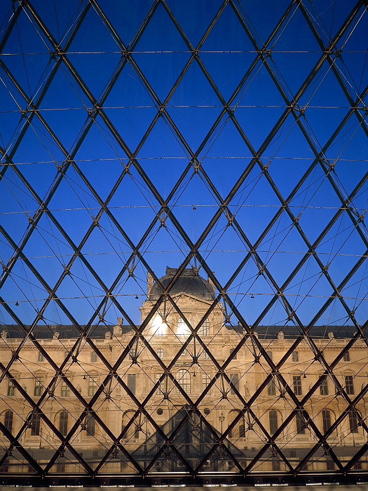 View from inside the glass Pyramid by architect I. M. Pei in front of the Louvre, Paris, France, Europe