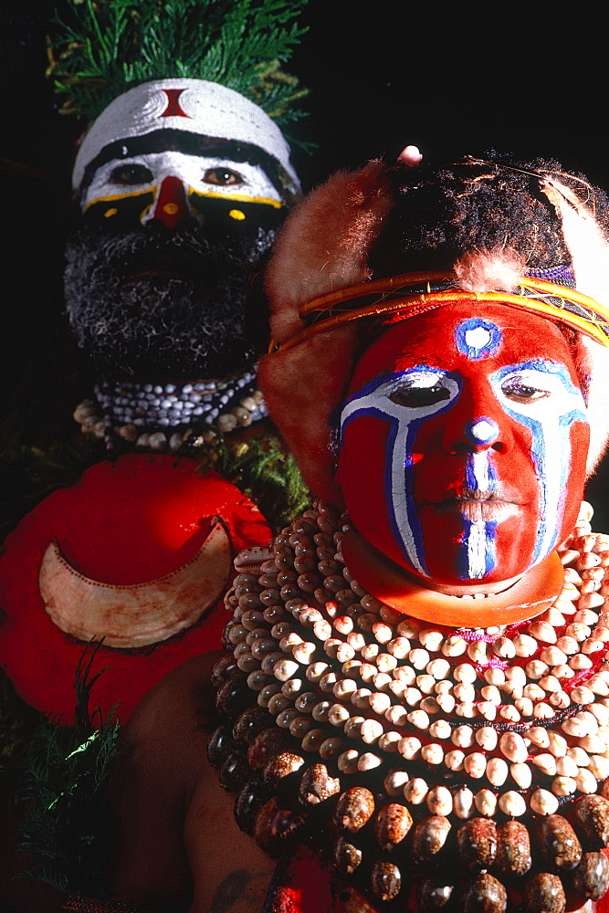Papua New Guinea, Port Moresby, Traditional Sepik Tribe Sacred Dance, Man And Woman Preparing To Dance