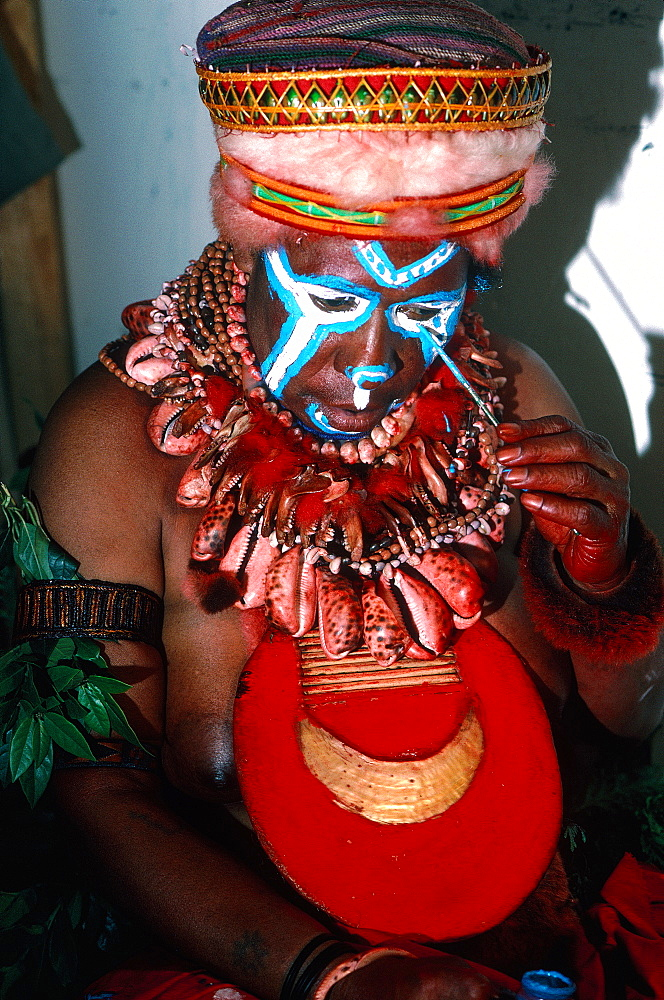 Papua New Guinea, Port Moresby, Traditional Sepik Tribe Sacred Dance, Woman Making Up
