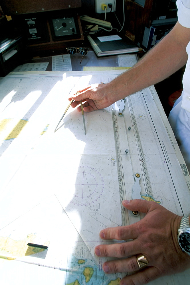 Crew member with navigation chart, cruise ship, Southeast Asia, Asia - 700-9838