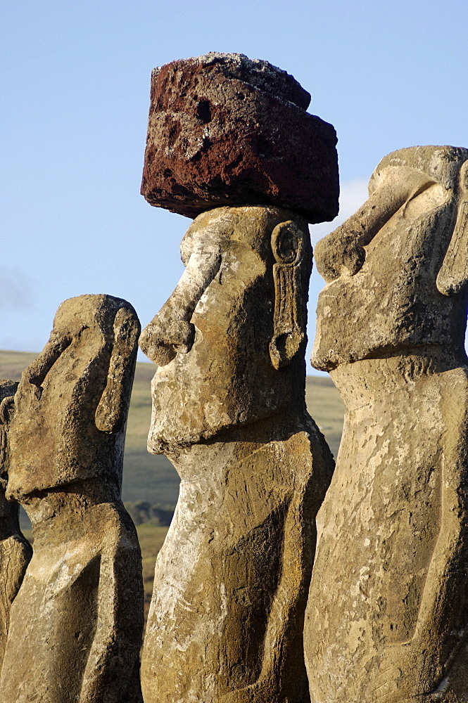 Three of the fifteen huge moai statues standing with their backs to the ocean, restored by archaeologists after destruction in 1960 by a tidal wave, Ahu Tongariki, Easter Island, UNESCO World Heritage Site, Chile, South America