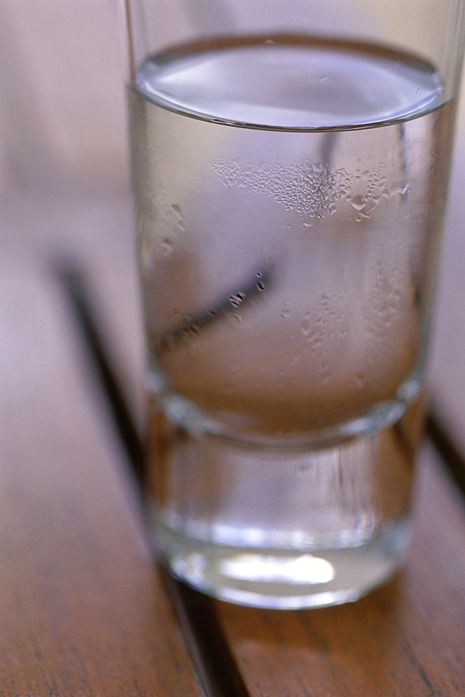 Close-up of a single glass of water on a table