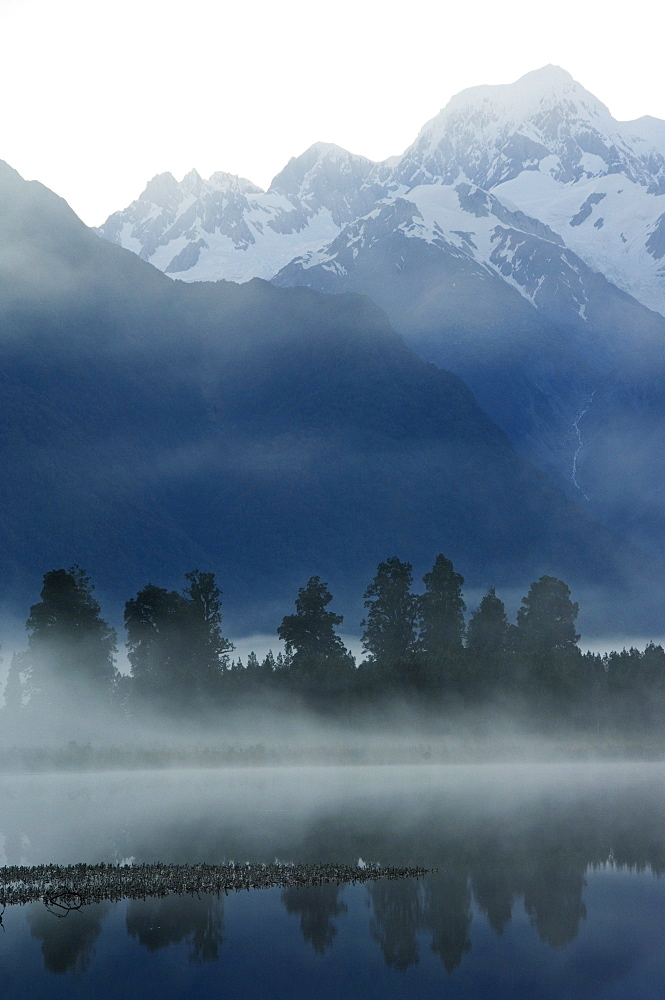 Lake Matheson and Mount Tasman in early morning mist, South Island, New Zealand, Pacific