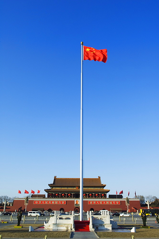 Chinese National flag infront of the Gate of Heavenly Peace in Tiananmen Square Beijing China