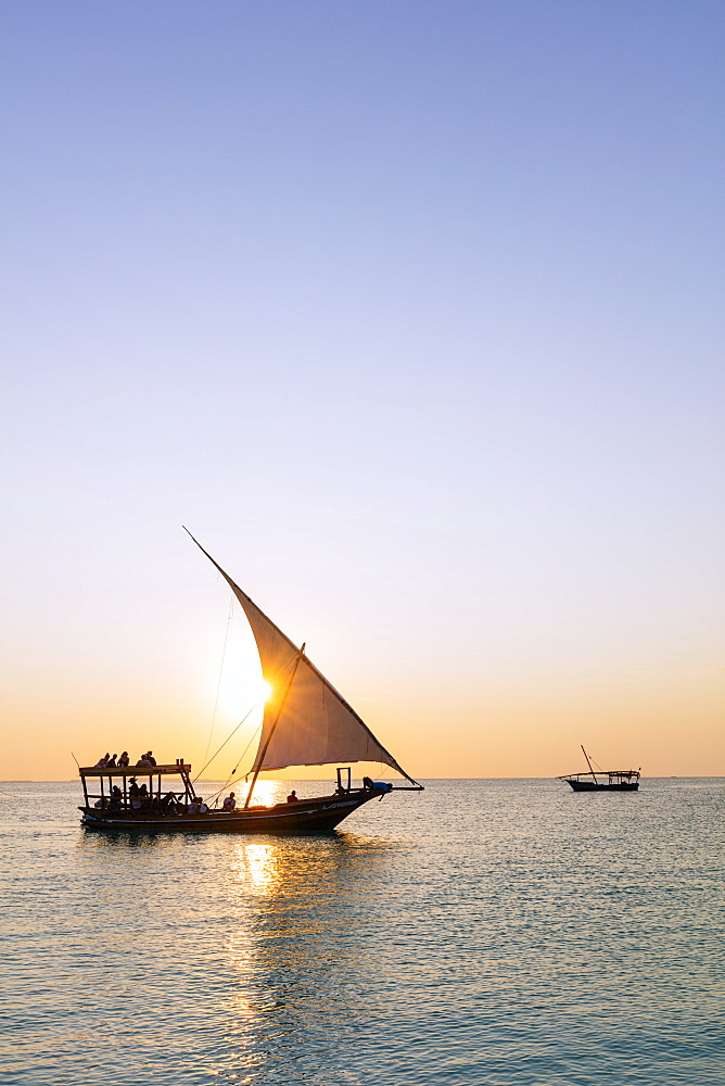 East Africa, Tanzania, Zanzibar island, Nungwi, tourists on a sunset cruise