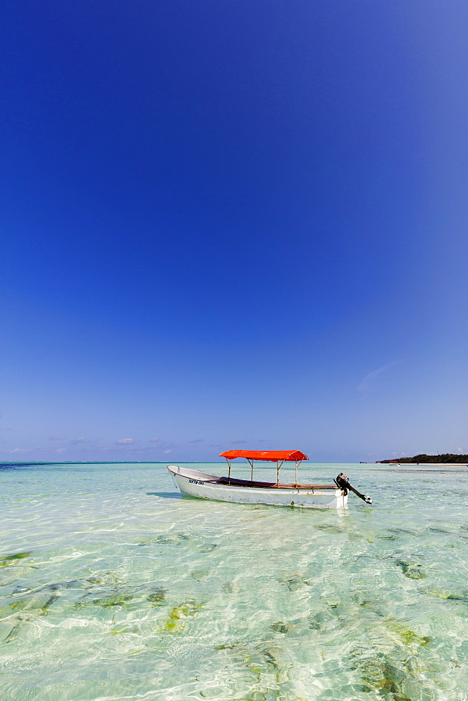 East Africa, Tanzania, Zanzibar island, Pingwe, small boat in crystal clear water