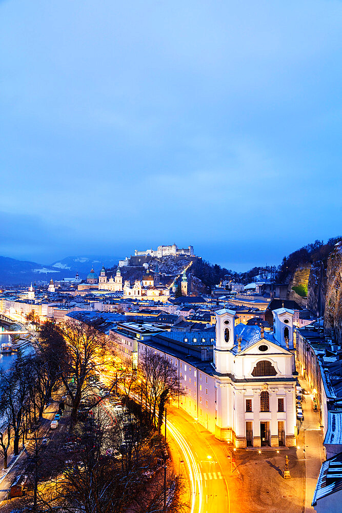 View over the old town, UNESCO World Heritage Site, Markus Church and Hohensalzburg Castle at dusk, Salzburg, Austria, Europe