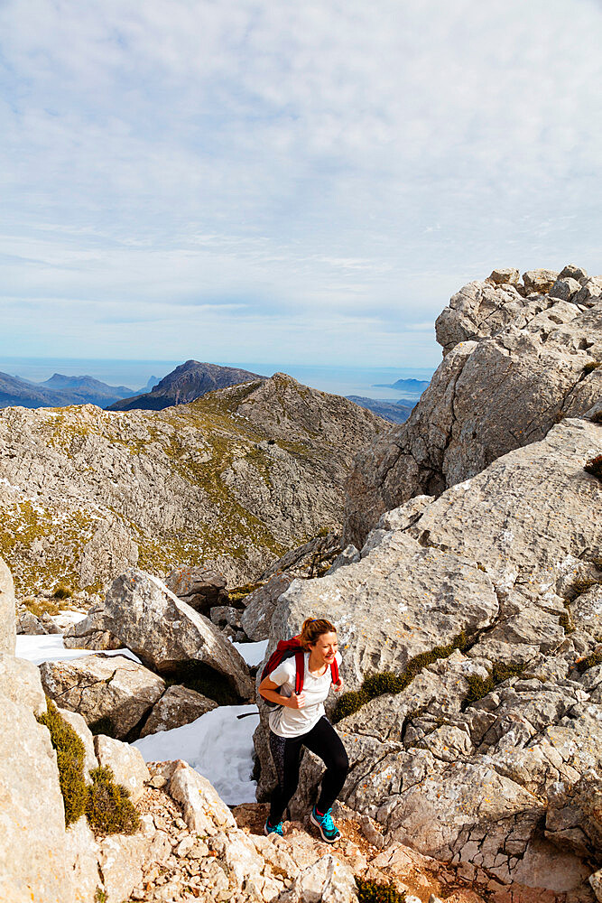 Serra de Tramuntura, hiker on Puig de Massanella Mallorca's highest accessible peak, Majorca, Balearic Islands, Spain, Mediterranean, Europe
