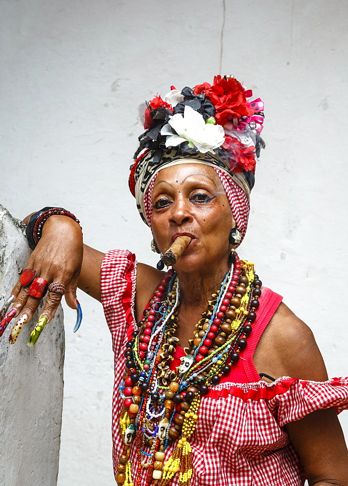 Woman smoking cigar, old Havana, Cuba, West Indies, Caribbean, Central America