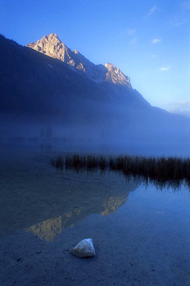 Early morning fog over Ferchensee, Mittenwald, Wetterstein Alps, Germany, Europe