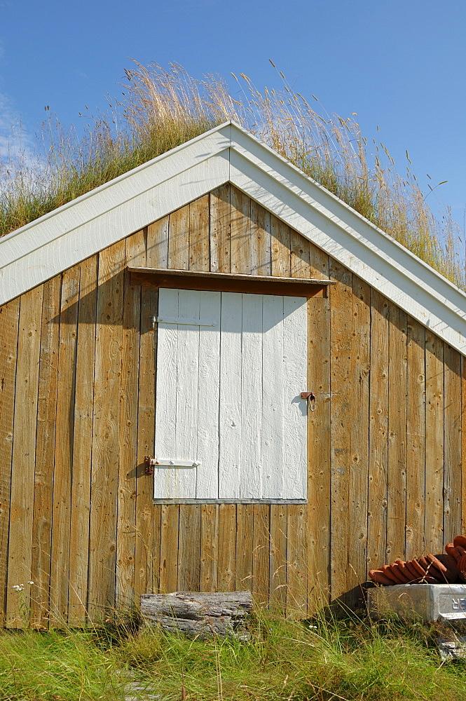 Turf roofed wooden hut, Kvaloya island, west of Tromso, Norway, Scandinavia, Europe