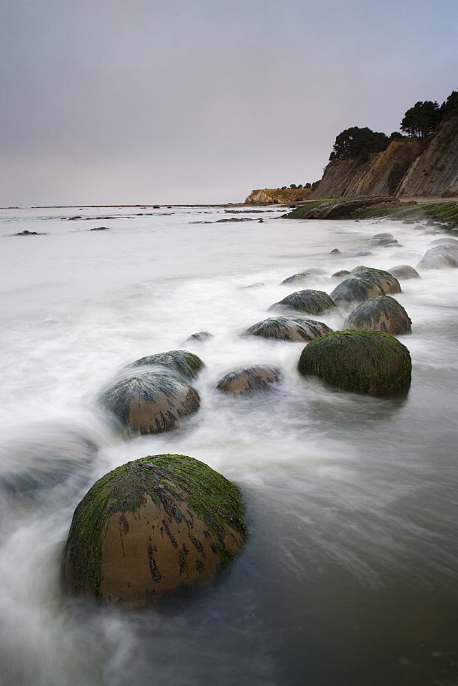 Boulders, known as Bowling Balls, in the surf, Bowling Ball Beach, California, United States of America, North America