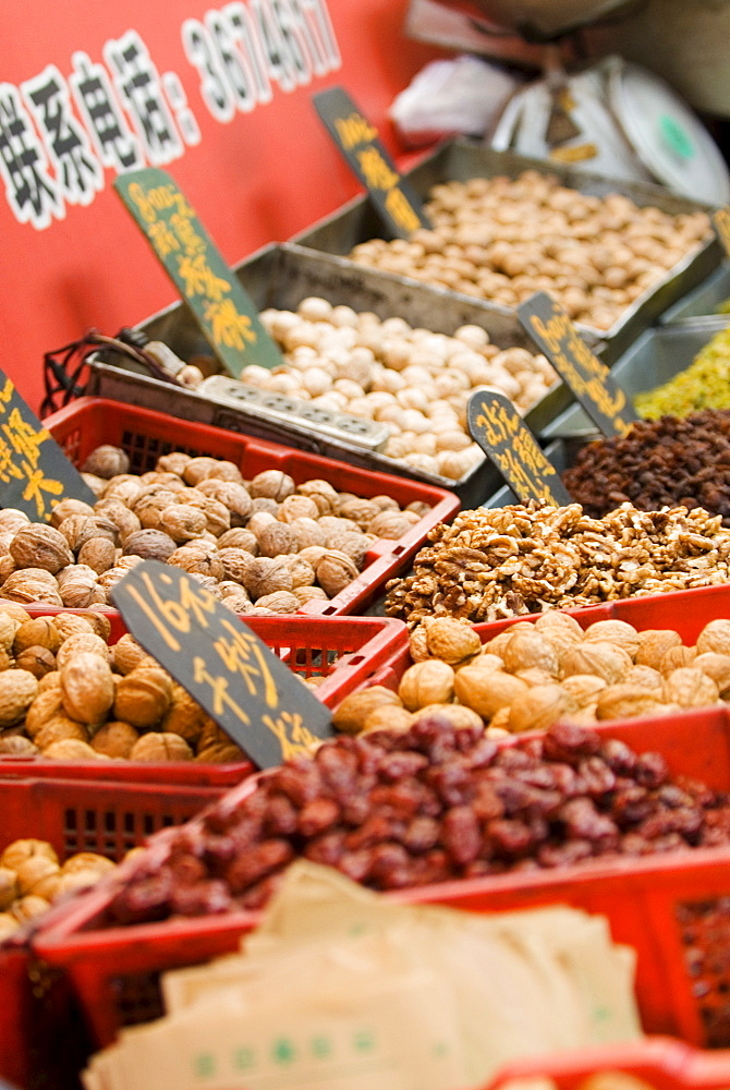 Nuts for sale at market, Xining, Qinghai, China, Asia