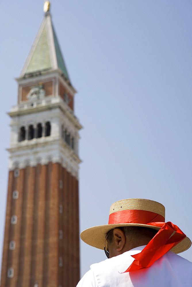 Campanile and gondolier, St. Mark's Square, Venice, Veneto, Italy, Europe
