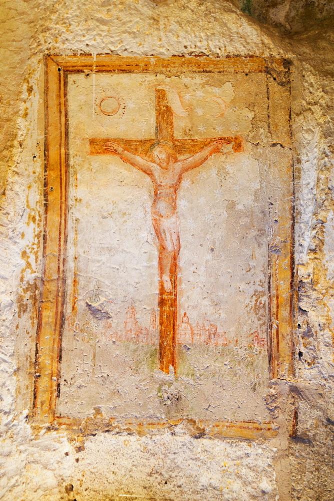 Crucifix fresco in a cave church in the Sassi area of Matera, Basilicata, Italy, Europe