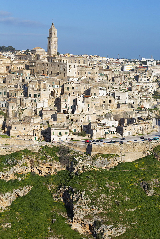 View of the ravine and the Sassi area of Matera with Matera Cathedral, Matera, Basilicata, Italy, Europe