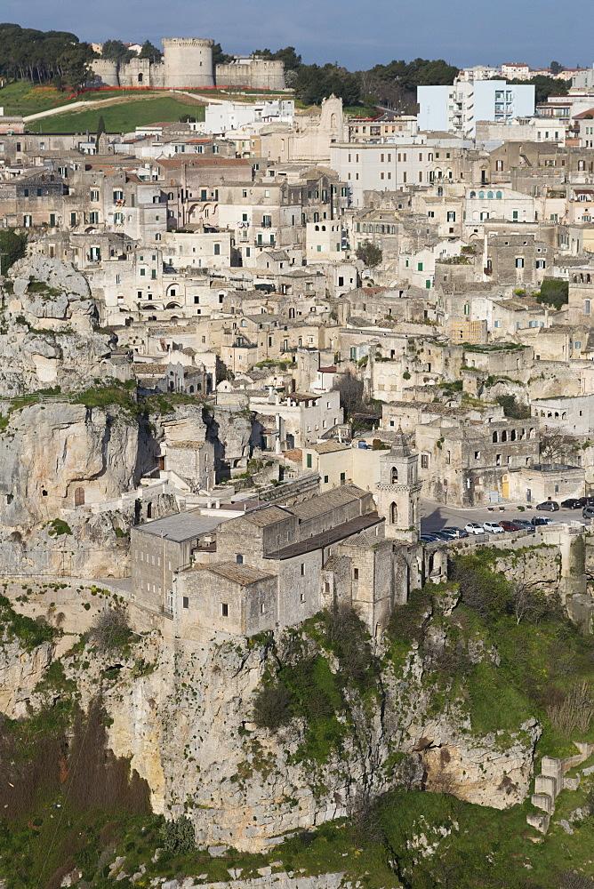 View of Chiesa di San Pietro Caveoso in the Sassi area of Matera and the ravine, Basilicata, Italy, Europe