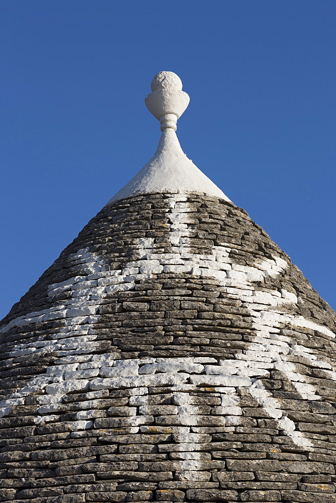 Sun painted on roof of traditional trullo in Alberobello, UNESCO World Heritage Site, Puglia, Italy, Europe