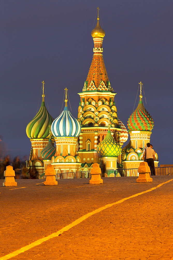 Onion domes of St. Basil's Cathedral in Red Square illuminated at night, UNESCO World Heritage Site, Moscow, Russia, Europe