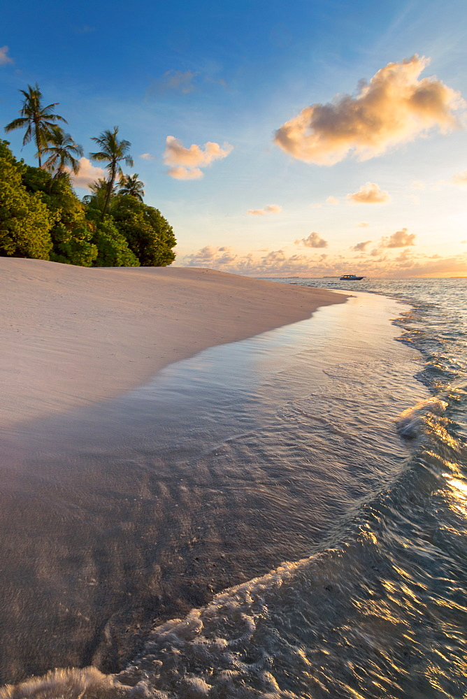 Morning light on a deserted beach on an island in the Northern Huvadhoo Atoll, Maldives, Indian Ocean, Asia