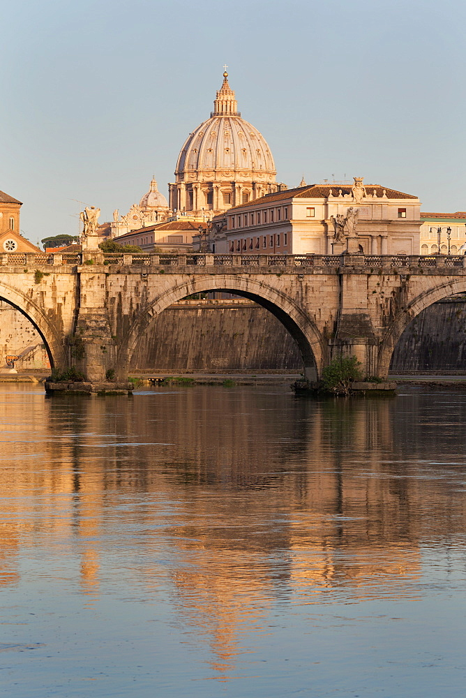 Ponte Sant' Angelo bridge and St. Peter's Basilica reflected in the River Tiber, Rome, Lazio, Italy, Europe
