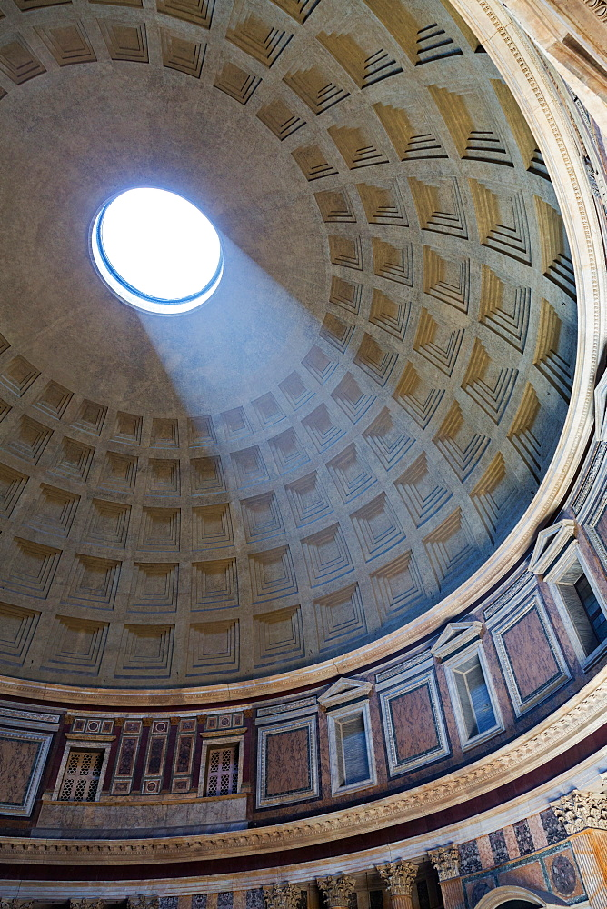 A shaft of light through the dome of the Pantheon, UNESCO World Heritage Site, Rome, Lazio, Italy, Europe