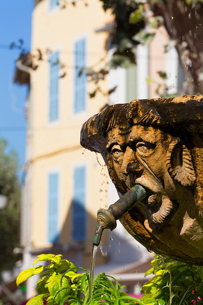 Fountain in the form of a man in Cassis old town, Cassis, Provence, France, Europe
