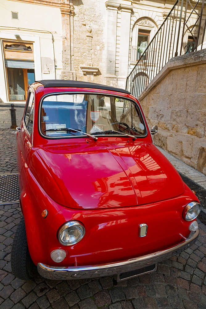 Old Fiat car parked in a quiet side street in Noto, Sicily, Italy, Europe
