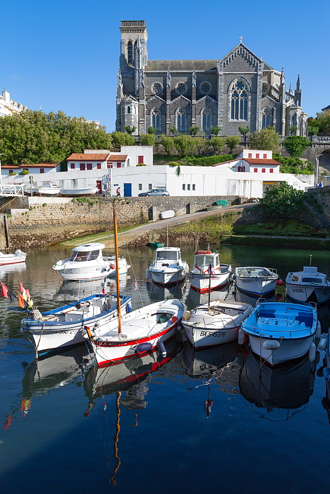 Small port with traditional fishing boats and Eglise Sainte Eugenie in Biarritz, Pyrenees Atlantiques, Aquitaine, France, Europe - 785-2079