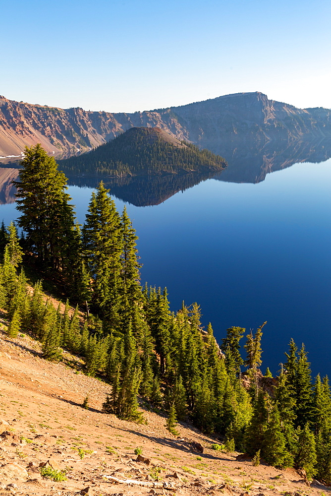 Wizard Island and the still waters of Crater Lake, the deepest lake in the USA, part of the Cascade Range