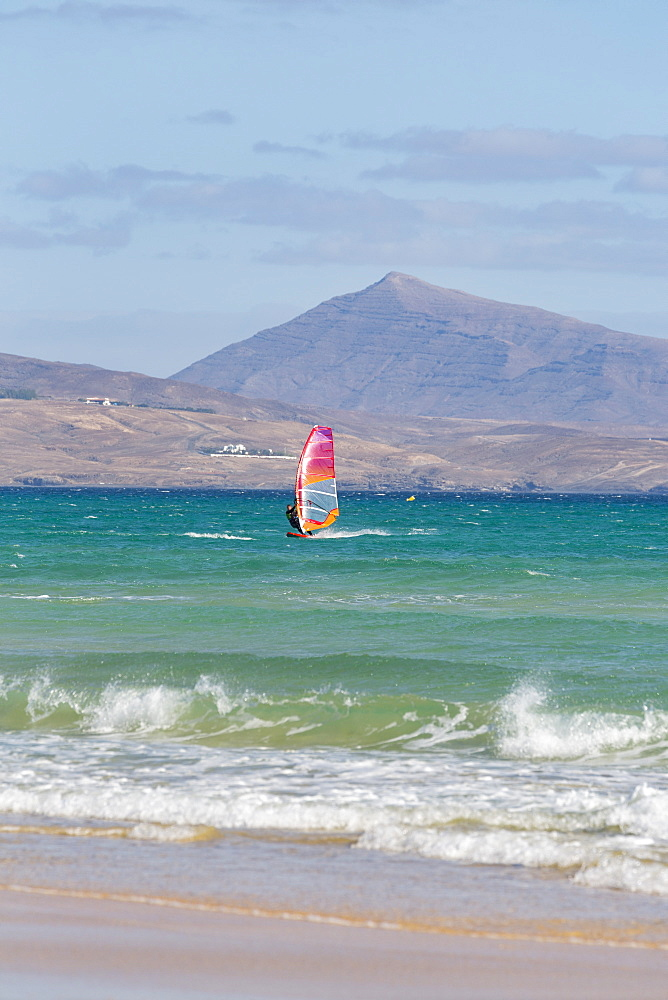 Wind-surfer off Playa de La Barca, Costa Calma, on the volcanic island of Fuerteventura, Canary Islands, Spain, Atlantic, Europe